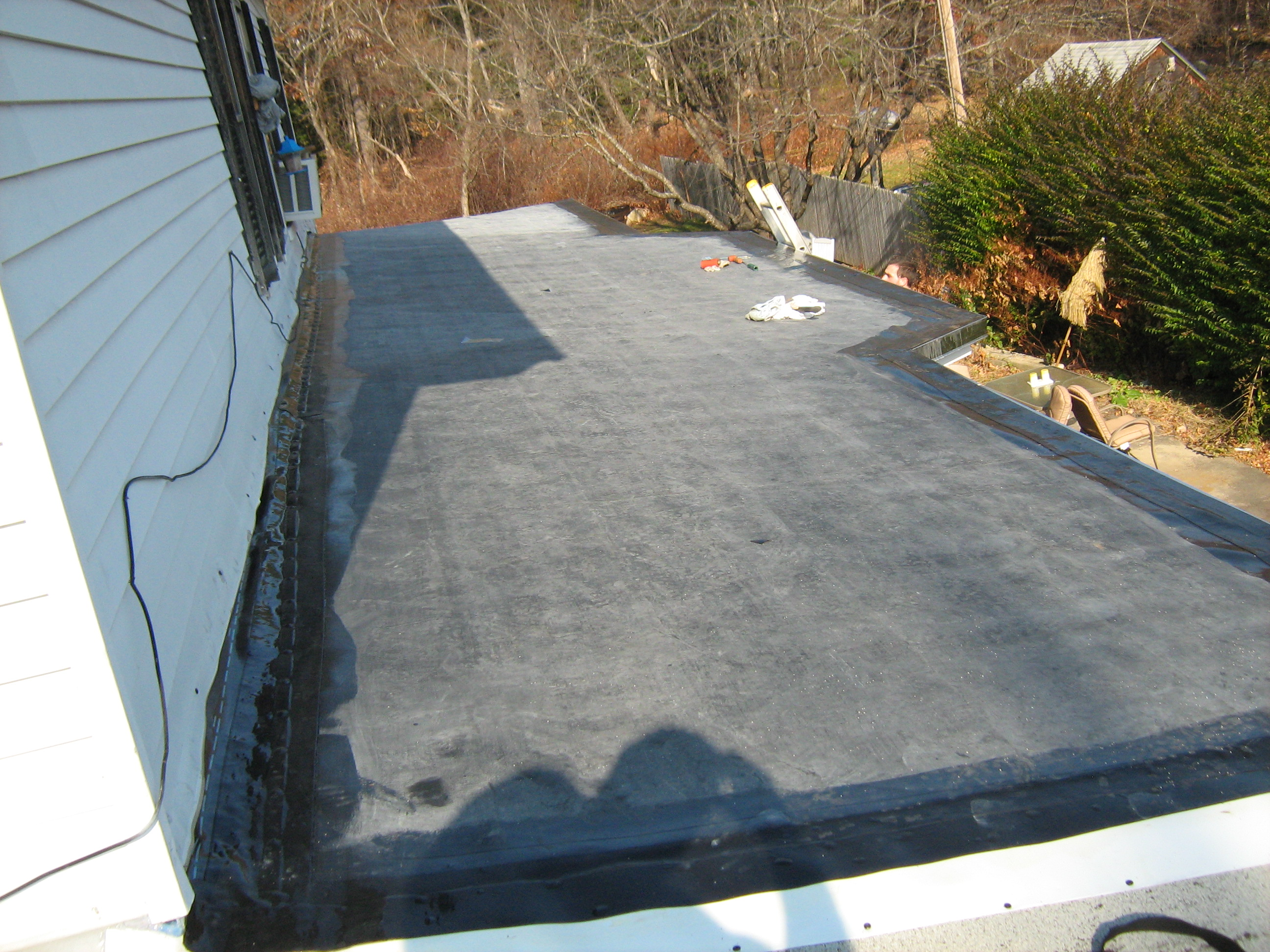 Ex. Rubber Roofing .